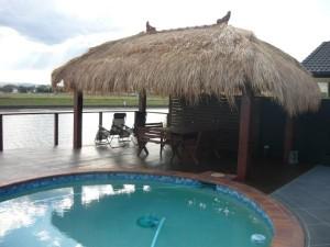 Pergolas patios decking bali huts pool decking for Pool builders yatala